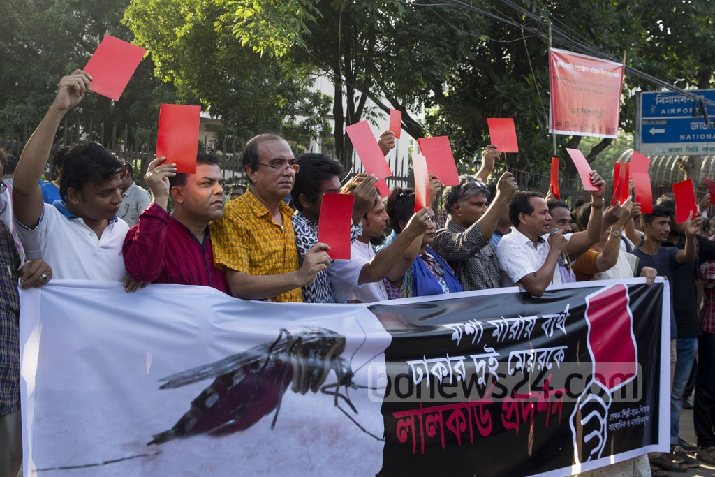 A citizens' platform shows 'red card' to the mayors of both Dhaka city corporations for failing to eradicate mosquitoes at a demonstration at Shahbagh on Saturday.