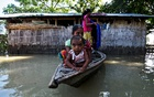 Villagers use a boat as they try to move to safer places at a flood-affected village in Darrang district in Assam, Jul 14, 2017. Reuters