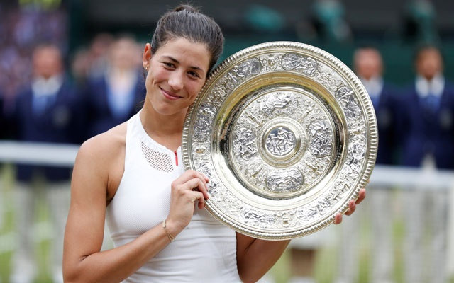 Tennis - Wimbledon - London, Britain - July 15, 2017 Spain's Garbine Muguruza poses with the trophy as she celebrates winning the final against Venus Williams of the US REUTERS/Matthew Childs