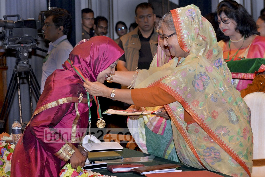 Prime Minister Sheikh Hasina confers medals and certificates on the winners of Bangabandhu National Agriculture Award given for the Bangla calendar years 1421 and 1422 at Osmani Memorial Auditorium on Sunday.