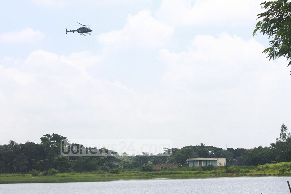 A RAB helicopter hovering over a house where suspected militants holed up at Ashulia in Savar on Sunday.