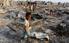 A boy walks among debris after fire destroyed shelters at a camp for internally displaced Rohingya Muslims in the western Rakhine State near Sittwe, Myanmar May 3, 2016. Reuters