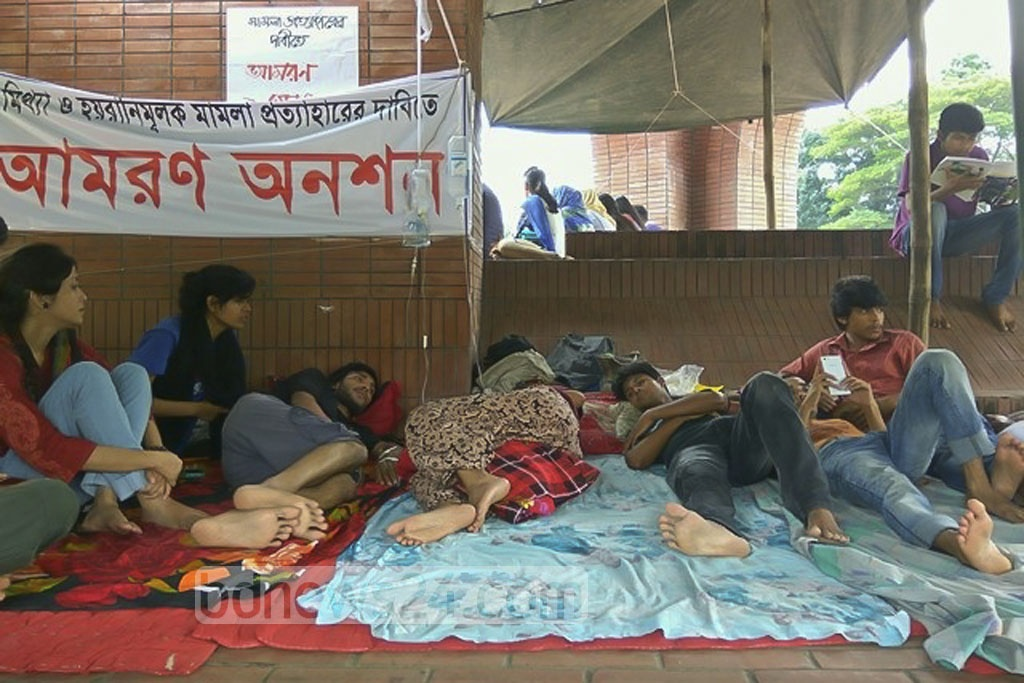 Jahangirnagar University students continued their hunger strike for the third consecutive day on Monday demanding withdrawal of a case filed against 56 students.