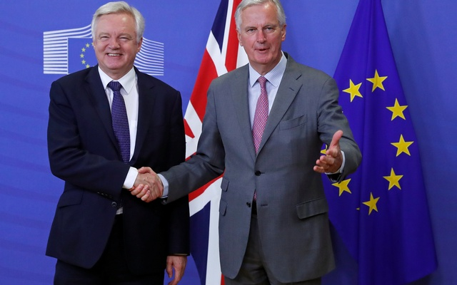 UK Secretary of State for Exiting the European Union David Davis (L) is welcomed by the European Commission's Chief Brexit Negotiator Michel Barnier at the start of a first full round of talks on Britain's divorce terms from the European Union, in Brussels, Belgium Jul 17, 2017. Reuters