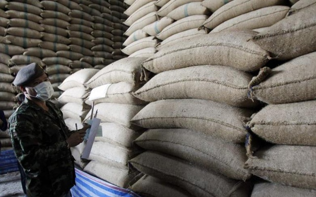 A soldier checks sacks of rice at a warehouse in Ayutthaya province, north of Bangkok July 3, 2014. Reuters