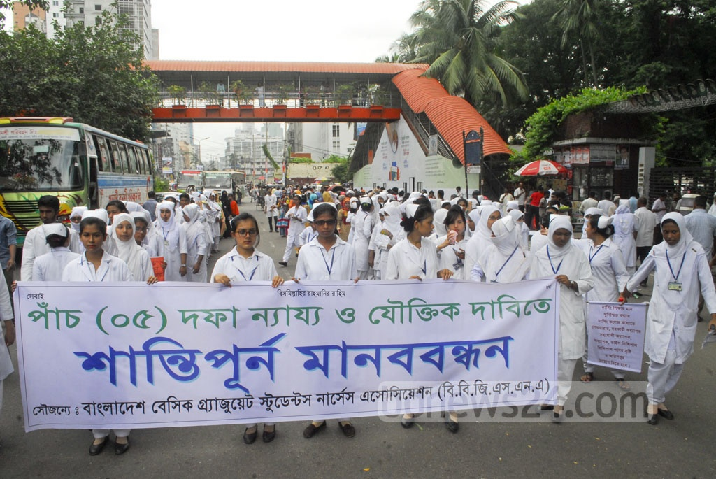 Nurses under the banner of Bangladesh Basic Graduate Nurses Association rally in front of the National Press Club in Dhaka on Tuesday to press home their five-point demands, including revision of pay scale.
