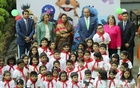 Invited guests pose for a group photo along with the children at the inauguration ceremony of a new Sisimpur project at Bengal Multimedia Studio at Tejgaon. Photo: abdul mannan