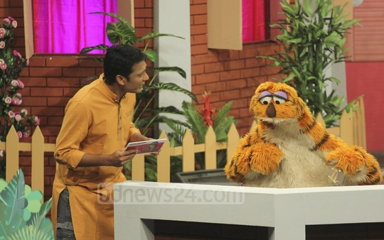 Puppetshow Sisimpur's character 'Halum' interacts with one of the hosts during the inauguration programme of a new project of the TV show. Photo: abdul mannan