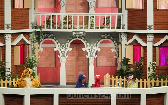 Puppetshow Sisimpur's 'Halum' and 'Tuktuki' with two other characters at the inauguration ceremony of a new project of the popular show on Wednesday. Photo: abdul mannan