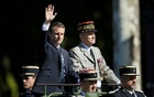 President Emmanuel Macron and Chief of the Defence Staff French Army General Pierre de Villiers arrive in a command car for the traditional Bastille Day military parade on the Champs-Elysees in Paris, France, July 14, 2017. Reuters