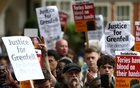 Demonstrators protest against the Grenfell Tower fire outside a Kensington and Chelsea Council meeting at Kensington Town Hall in London, Britain Jul 19, 2017. Reuters