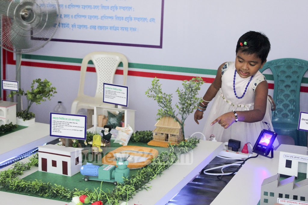 Children are visiting the Fish Fair at Krishibid Institution along with adults.