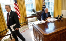 FILE PHOTO: White House Communications Director and spokesman Sean Spicer (L) stands with US President Donald Trump at the conclusion of an interview with Reuters in the Oval Office at the White House in Washington, US February 23, 2017. Reuters