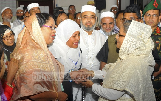Prime Minister Sheikh Hasina speaking with pilgrims at the Ashkona Hajj Camp on Saturday after inaugurating this year's Hajj prgramme. Photo: Yeasin Kabir Joy