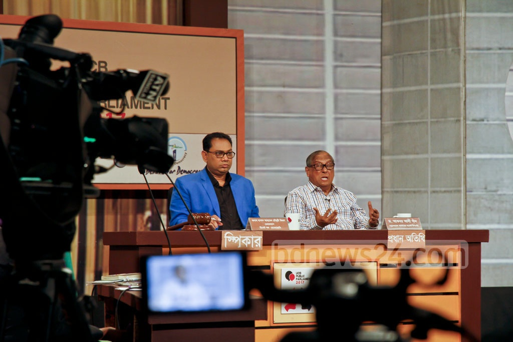Former adviser to a caretaker government Akbar Ali Khan speaks at a programme titled 'Debate for Democracy' on the Election Commission's work plan for the next parliamentary polls at BFDC auditorium in Dhaka on Saturday.
