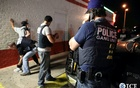 File Photo: Federal agents with the US Immigration and Customs Enforcement's (ICE) Homeland Security Investigations (HSI) detain a man in this handout picture taken in Dallas, Texas Mar 30, 2014 and released May 1, 2014. Reuters/ICE. File Photo via Reuters.