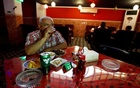 Iraqis numb pain of Islamic State in newly reopened bar