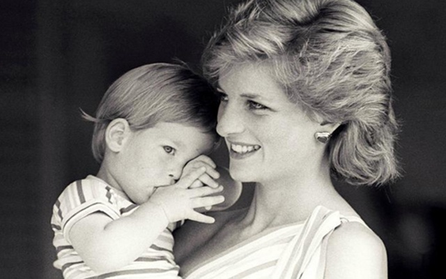 FILE PHOTO: Britain's Princess Diana holds Prince Harry during a morning picture session at Marivent Palace, where the Prince and Princess of Wales are holidaying as guests of King Juan Carlos and Queen Sofia, in Mallorca, Spain August 9, 1988.