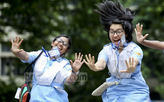 Students of Viqarunnisa Noon School and College react after their HSC results were published on Sunday. Photo: asaduzzaman pramanik