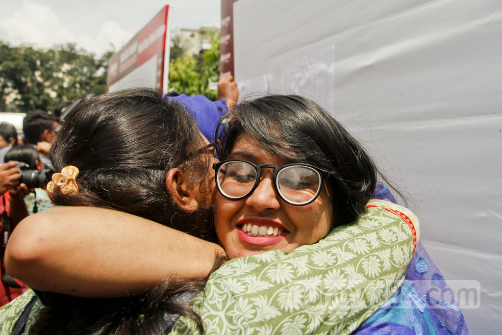 Students express joy at RAJUK Uttara Model College after finding their HSC results. Photo: tanvir ahammed