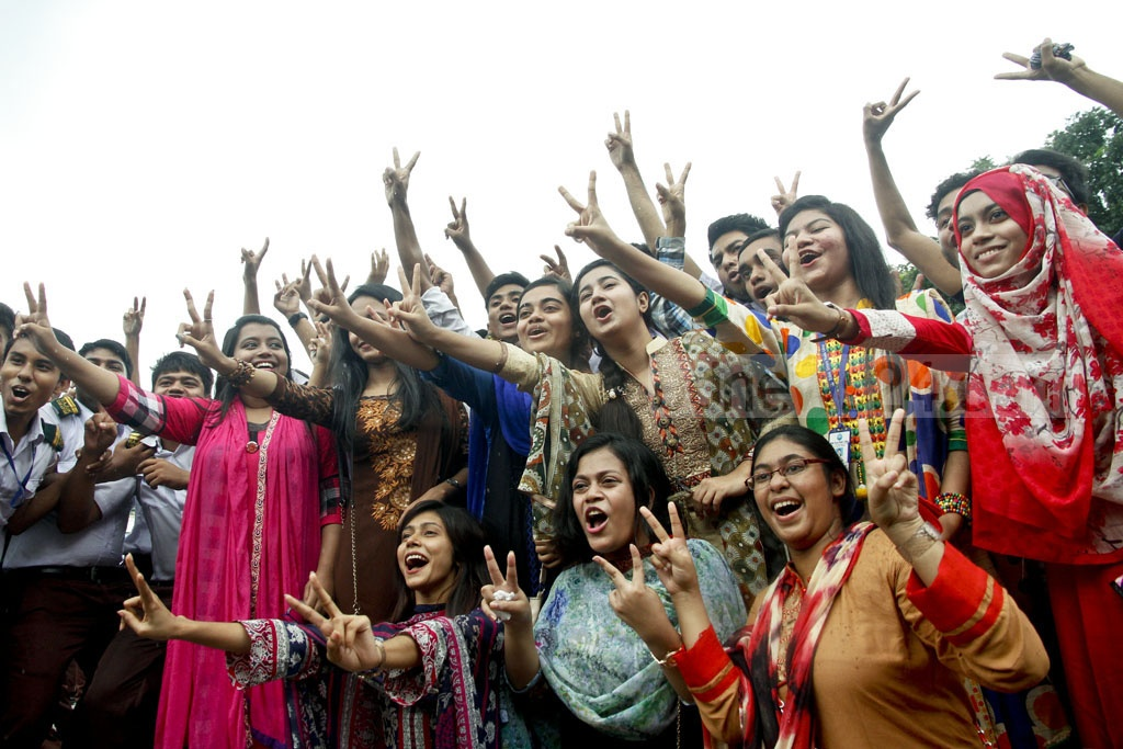 V for Victory! Students of RAJUK Uttara Model College react after their HSC results were released on Sunday. Photo: tanvir ahammed
