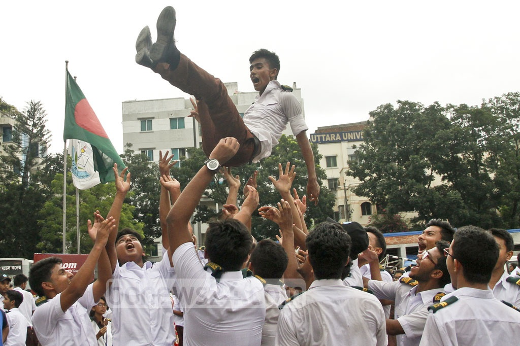 Students of other grades in RAJUK Uttara Model College join the celebration of the institution's achievement in the HSC exams. Photo: tanvir ahammed