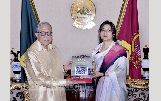 State Minister for Post and Telecommunications Tarana Halim hands over an album with stamps portraying the genocide of 1971 to President Abdul Hamid at Bangabhaban on Sunday. Photo: Press Wing, Bangabhaban