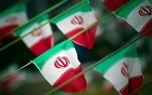 Iran's national flags are seen on a square in Tehran Feb 10, 2012, a day before the anniversary of the Islamic Revolution. Reuters File Photo