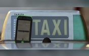 The car-sharing service app Uber on a smartphone next to a taxi sign is seen in this photo illustration taken in Madrid on Dec 10, 2014. Reuters