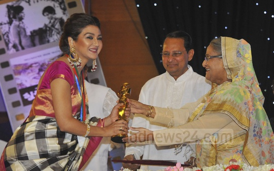 Joya Ahsan smiles as she is awarded as the best actress by Prime Minister Sheikh Hasina. Photo: Yeasin Kabir Joy