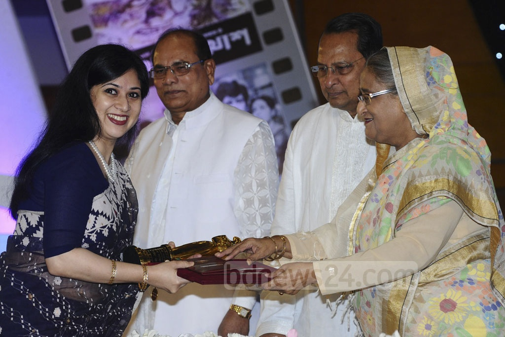Winners of National Film Award 2015 receive trophies from Prime Minister Sheikh Hasina on Monday.