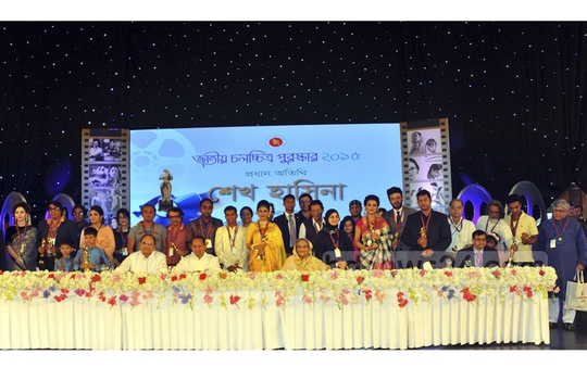 Winners of the National Film Award 2015 come together for photographs with Prime Minister Sheikh Hasina and other guests of the ceremony held in Dhaka on Monday. Photo: Yeasin Kabir Joy