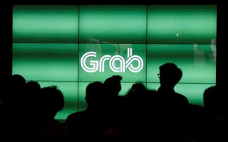 People wait for the start of ride-hailing company Grab's fifth anniversary news conference in Singapore Jun 6, 2017. Reuters File Photo