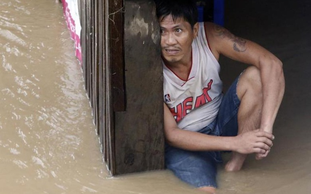 Representational Image: A man waits for rescuers in his partially submerged house during floods brought by tropical depression