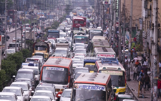 Traffic chaos builds up on Kazi Nazrul Islam Avenue in Dhaka amid incessant rain on Tuesday. Photo: abdul mannan