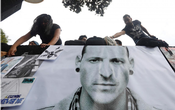 Fans stick posters as they gather at Revolucion monument to pay tribute to Chester Bennington, Linkin Park frontman, following the singer's death by suicide, in Mexico City, July 23, 2017. Reuters