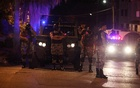 Policemen are seen near the Israeli embassy in Amman, Jordan July 23, 2017. Reuters
