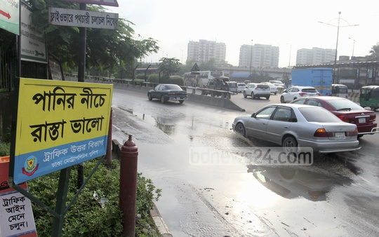 Dhaka Metropolitan Police traffic department ​assures drivers that the roads under water are safe to drive. It ​has installed a signboard that says 'the submerged road is okay to driver on' ​at the ​start​ of the flyover that leads to Mirpur from the west side of Radisson Blu hotel. Th​is​ section ​of the road ​goes underwater ​with small downpour​. photo: asif mahmud ove