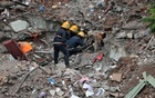 Firefighters remove debris as they search for survivors at the site of a collapsed building in the suburbs of Mumbai, India Jul 26, 2017. Reuters