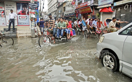 Rickshaw-van is one of the main choices of the people commuting waterlogged Nazimuddin Road. Photo: tanvir ahammed