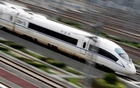 A China Railway High-speed bullet train runs towards Beijing South Railway Station July 25, 2011. Reuters
