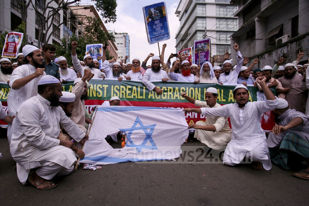 Several Islamist organisations burned Israel's national flag at Dhaka's Paltan on Friday protesting the Israeli security measures and restrictions around the Al-Aqsa Mosque in Jerusalem.