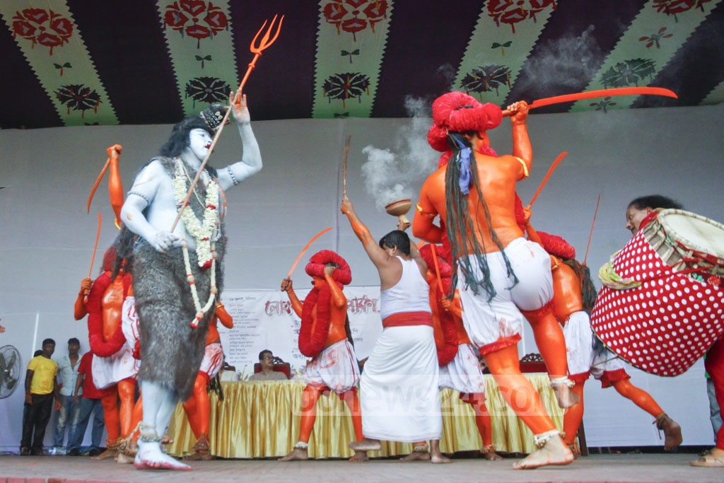 Ajit Goswami's troupe from Bikrampur performs 'Lal Kachh', a hundreds-year old traditional performance depicting a group of soldiers led by Hindu god Shiva appearing on earth with the mission to ward off evil forces, at the folk festival. Photo: tanvir ahammed