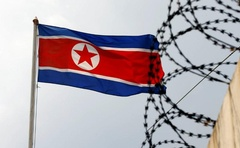 The North Korea flag flutters next to concertina wire at the North Korean embassy in Kuala Lumpur, Malaysia March 9, 2017. Reuters