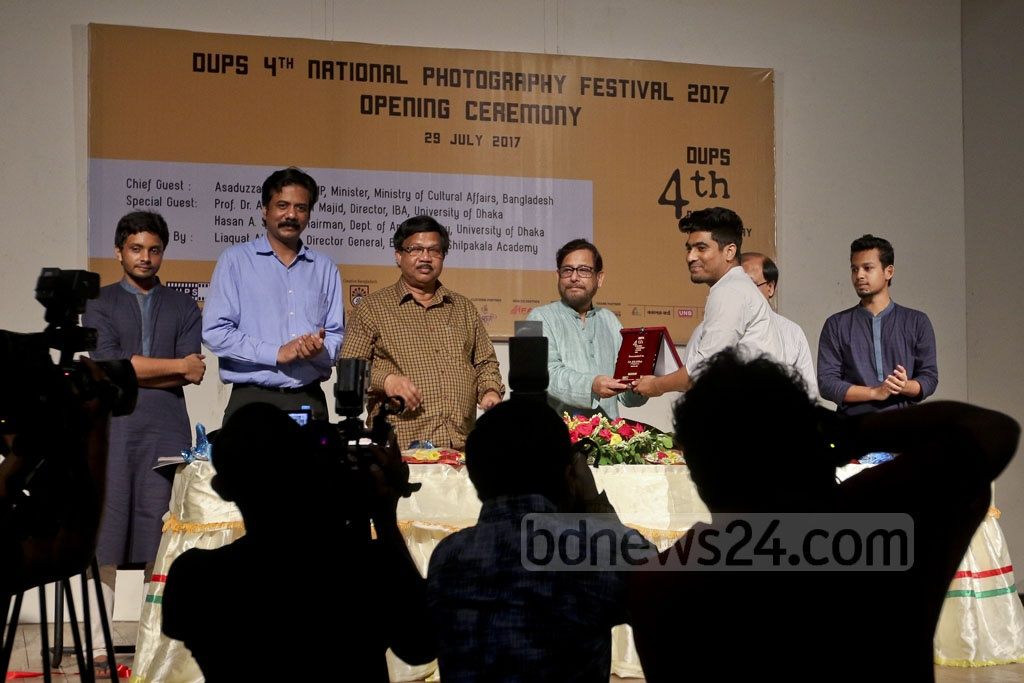 Cultural Affairs Minister Asaduzzaman Noor distributes awards among the winners of a photography competition at the opening ceremony of the 4th National Photography Festival, organised by Dhaka University Photographic Society or DUPS and Bangladesh Shilpakala Academy at the academy on Saturday. Photo: asaduzzaman pramanik