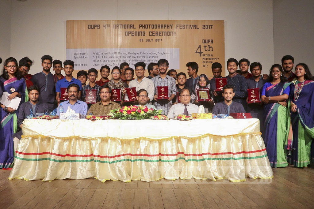 Guests pose for a photo with the winners of a photography competition at the opening ceremony of the 4th National Photography Festival, organised by Dhaka University Photographic Society or DUPS and Bangladesh Shilpakala Academy at the academy on Saturday. Photo: asaduzzaman pramanik