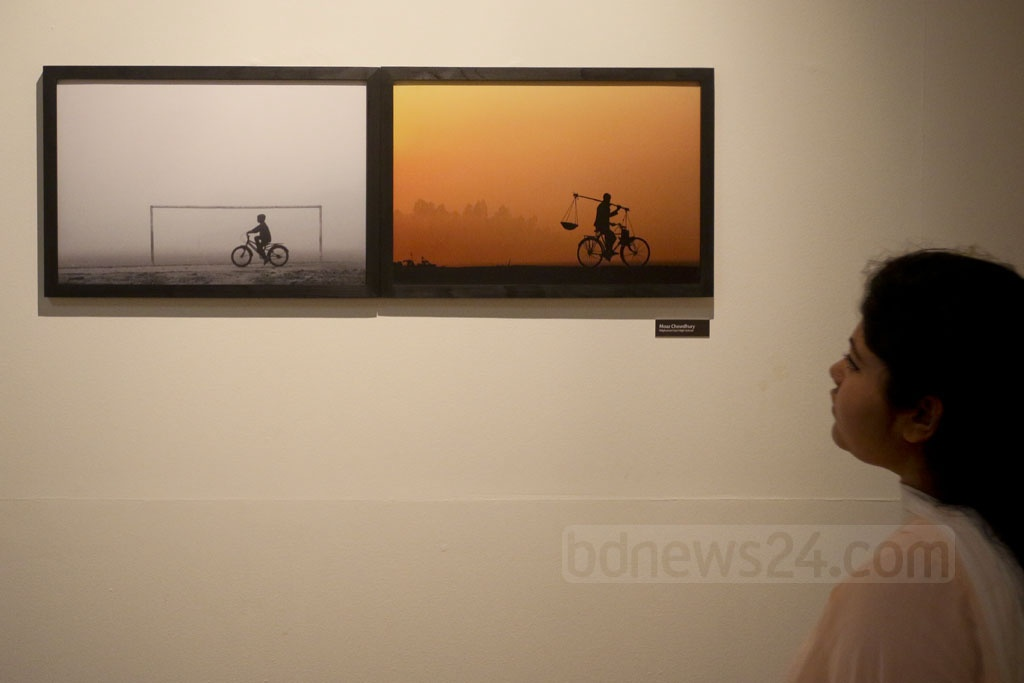A visitor at the 4th National Photography Festival after the opening ceremony on Saturday. Photo: asaduzzaman pramanik