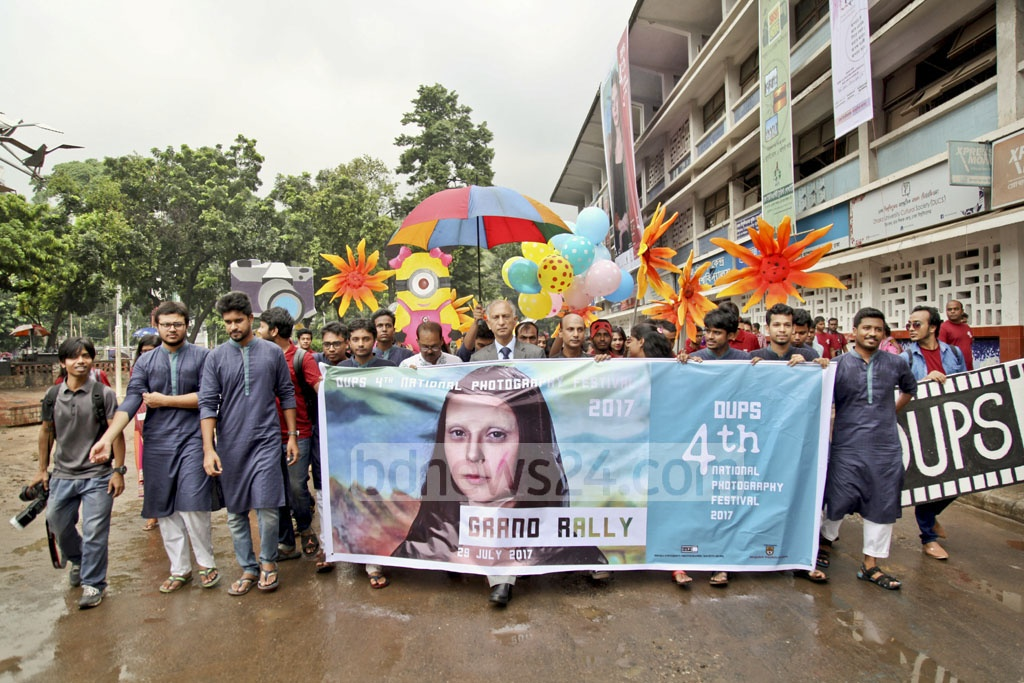 A procession for the DUPS 4th National Photography Festival, an event organised by the Dhaka University Photographic Society and the Bangladesh Shilpakala Academy, moves through the Dhaka University area on Saturday.