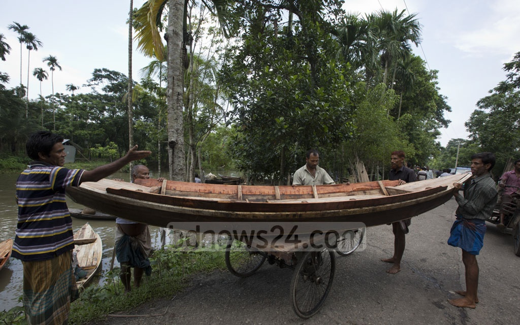 A buyer returning home with a new boat from the Aatghar canal market.