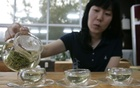 A woman pours hot water to make green tea at a traditional tea house in Boseong, about 397 km (246 miles) south of Seoul, Sep 23, 2007, which is a famous place in Korea for its extensive and beautiful green tea fields, and has the nation's largest tea outputs. Reuters